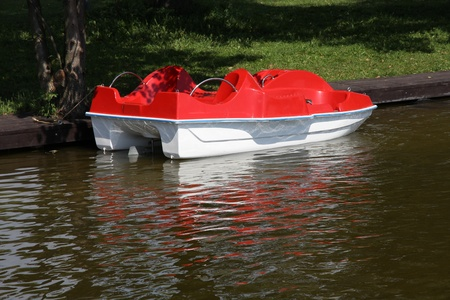 Masuria (Mazury) - famous lake district in Poland. Red paddle boat (pedalo). Wydminskie lake. Stock Photo - 10749143