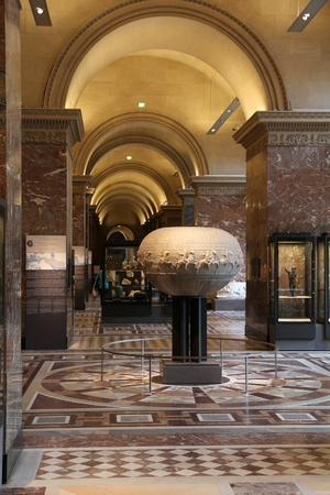 consistently: PARIS - JULY 22: Ancient Greece artifacts on July 22, 2011 in Louvre Museum, Paris, France. With 8,5m annual visitors, Louvre is consistently the most visited museum worldwide.