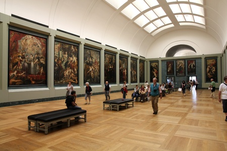consistently: PARIS - JULY 22: Rubens paintings on July 22, 2011 in Louvre Museum, Paris, France. With 8,5m annual visitors, Louvre is consistently the most visited museum worldwide.