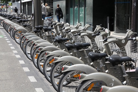 shared sharing: PARIS - JULY 24: Bicycle sharing station on July 24, 2011 in Paris, France. With 20,600 bicycles, Paris sharing system is largest in Europe.