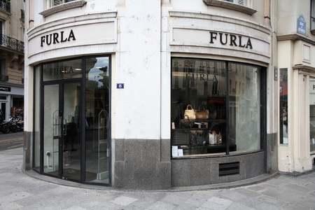 PARIS - JULY 24: Furla store on July 24, 2011 in Paris, France. The Italian fashion company is present in 64 countries with 296 single brand shops. It was founded in 1927. Stock Photo - 10781219