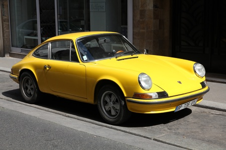recognized: PARIS - JULY 24: Porsche 911 classic parked on July 24, 2011 in Paris, France. Porsche 911 classic is one of the most iconic and recognized sports cars in the world. It was produced in 1963-1989.