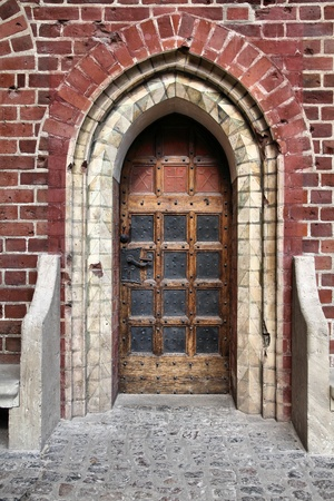 Door to Malbork castle in Pomerania region of Poland. UNESCO World Heritage Site. Teutonic Knights fortress also known as Marienburg.