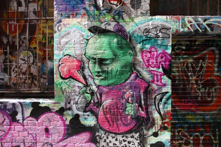 MELBOURNE, AUSTRALIA - FEBRUARY 9: Graffiti by various artists on February 9, 2008 in Hosier Lane, Melbourne, Australia. Hosier Lane a celebrated landmark due to its sophisticated urban art.