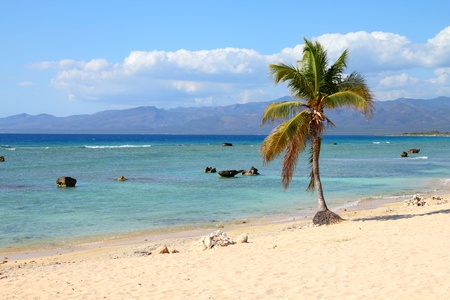 Cuba - famous Playa Ancon beach. Caribbean seaside destination. photo