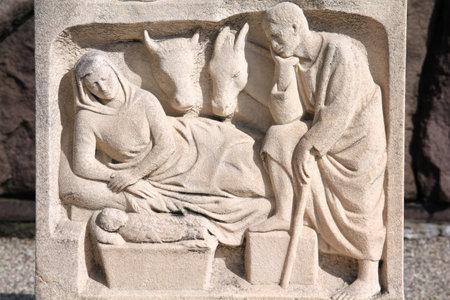 monumental cemetery: Milan, Italy. Old grave nativity scene sculpture at the Monumental Cemetery (Cimitero Monumentale). Religious art.