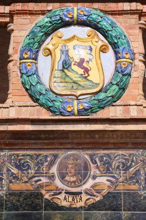plaza of arms: Famous ceramic decoration in Plaza de Espana, Sevilla, Spain. Coat of arms of Alava. Editorial