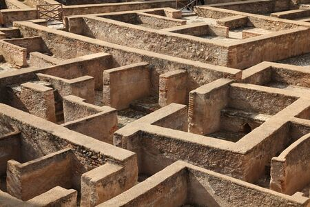 Granada in Andalusia region of Spain. Alhambra castle, Nasrid palace. UNESCO World Heritage Site. Building remains looking like a maze.