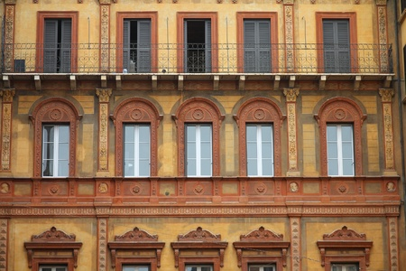 reggio emilia: Reggio Emilia, Italy - Emilia-Romagna region. Old residential architecture. Decorative windows. Editorial