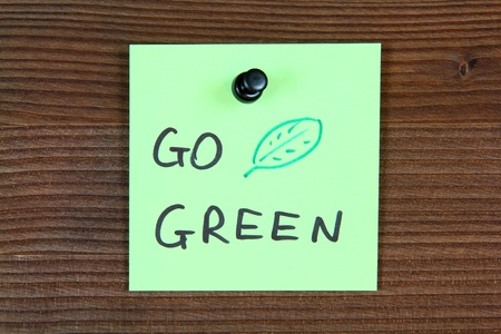 Sticky note with environment message - go green. Bulletin board. Stock Photo - 10987267