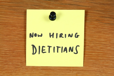Sticky note with employment opportunity message - dietitians hiring. Bulletin board. Stock Photo - 10987291