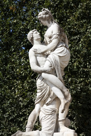 schoenbrunn: Vienna, Austria - statue of Abduction of Helen (Greek mythology) in Schoenbrunn Gardens, a UNESCO World Heritage Site. Stock Photo