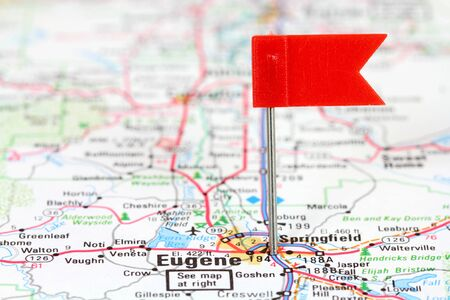 thumbtack: Eugene, Oregon. Red flag pin in an old map showing travel destination. Stock Photo