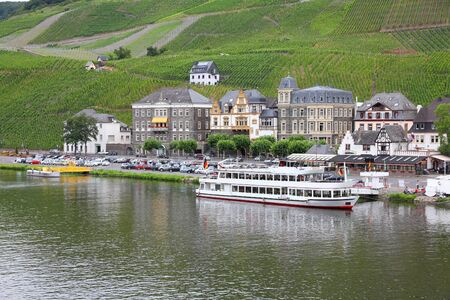 mosel: Bernkastel-Kues - town in Rhineland-Palatinate region of Germany. Old decorative houses and vineyards next to Mosel river. Editorial