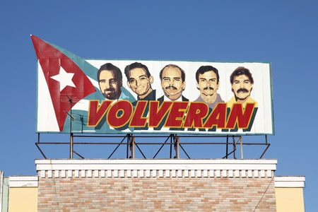 political prisoner: CIENFUEGOS, CUBA - FEBRUARY 3: Propaganda billboard in the street on February 3, 2011 in Cienfuegos, Cuba. The billboard depicts five Cubans detained by the US. Cuba claims theyre innocent.