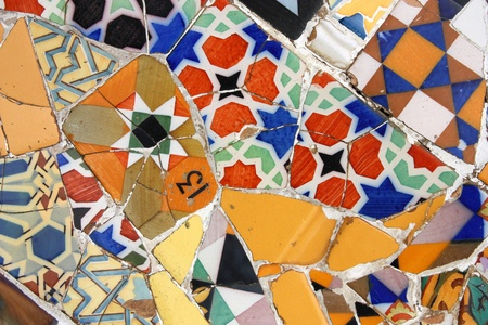 trencadi: BARCELONA, SPAIN - SEPTEMBER 13: Colorful mosaic in famous Parc Guell on September 13, 2009 in Barcelona, Spain. Gaudis creations are on of major factors influencing tourism in Barcelona. Editorial