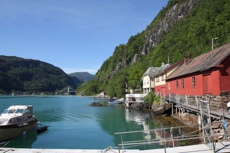hardanger: Norway - Hardanger fjord marina with anchored motorboats. Seaside landscape.