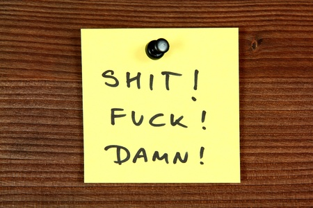 curse: Sticky note with angry offensive language - popular English curse words. Bulletin board.