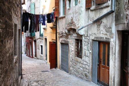 Croatia - Rovinj on Istria peninsula. Old town cobbled street.