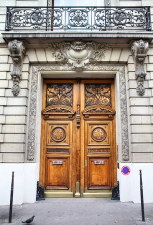 french doors: Paris, France - typical old apartment building. Wooden door. Stock Photo