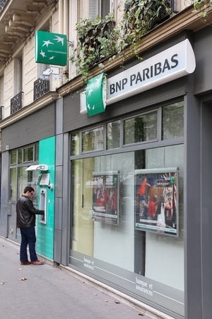 PARIS - JULY 23: BNP Paribas Bank branch on July 23, 2011 in Paris, France. Formed through merger in 2000, the bank is currently largest worldwide by assets ($2.68 trillion USD).