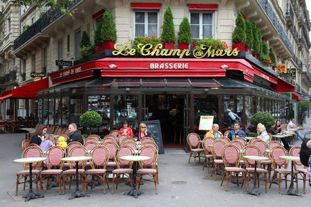 PARIS - JULY 21: Le Champ de Mars cafe on July 21, 2011 in Paris, France. Le Champ de Mars cafe is a typical establishment for Paris, one of largest metropolitan areas in Europe.