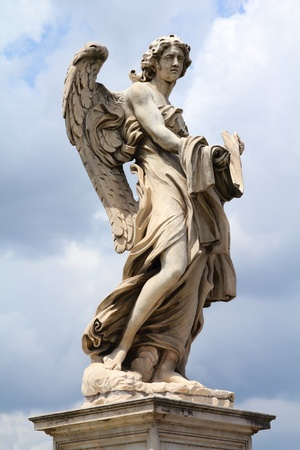 Rome, Italy. One of the angels at famous Ponte Sant Angelo bridge. Angel with the Garment and Dice statue by Paolo Naldini. photo