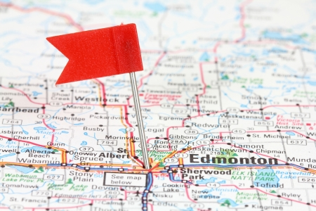 Edmonton in Alberta, Canada. Red flag pin on an old map showing travel destination. photo