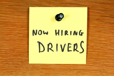 Sticky note with employment message - hiring drivers. Unemployment concept, job search. Bulletin board. Stock Photo - 11513306