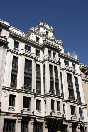 Vintage ornamental building at Gran Via in Madrid, Spain