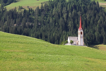 drava: Italy - beautiful alpine village, Prato Alla Drava. Small town with green pastures and Alps in background. Puster Valley in Trentino region.