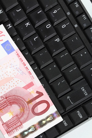 Online business - notebook keyboard and Euro currency money photo