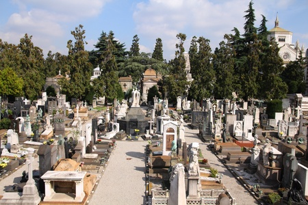 monumental cemetery: Milan, Italy. Famous landmark - the Monumental Cemetery (Cimitero Monumentale) with Famedio chapel in the background.