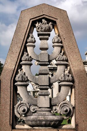 monumental cemetery: Menorah - Jewish symbol in a grave stone in Milan Monumental Cemetery