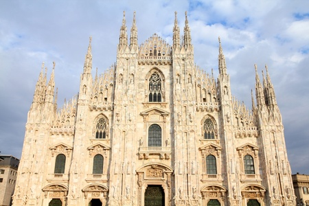 Cathedral of Milan. Catholic church in Italy. Gothic facade in sunset light. photo
