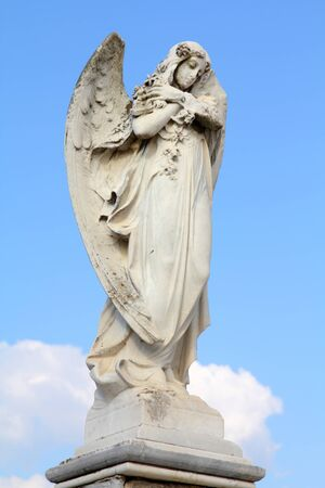 Cuba - angel statue in the cemetery of Cienfuegos. photo