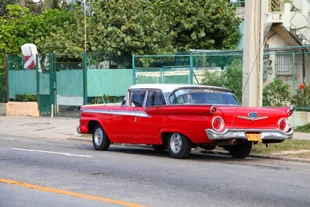 resulted: HAVANA - FEBRUARY 24: Classic American Ford car on February 24, 2011 in Havana. Recent change in law allows the Cubans to trade cars again. Old law resulted in very old fleet of private owned cars in Cuba.