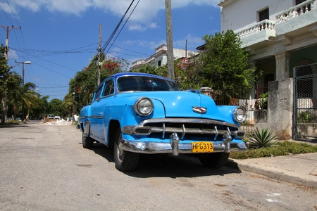 resulted: HAVANA - FEBRUARY 24: Classic American Chevrolet car on February 24, 2011 in Havana. Recent change in law allows the Cubans to trade cars again. Old law resulted in very old fleet of private owned cars in Cuba. Editorial