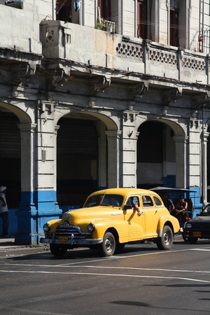 resulted: HAVANA - FEBRUARY 25: Classic American Pontiac car on February 25, 2011 in Havana. Recent change in law allows the Cubans to trade cars again. Old law resulted in very old fleet of private owned cars in Cuba.