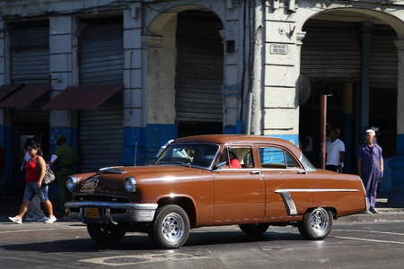 resulted: HAVANA - FEBRUARY 24: Classic American Mercury car on February 24, 2011 in Havana. Recent change in law allows the Cubans to trade cars again. Old law resulted in very old fleet of private owned cars in Cuba.