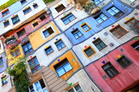reasons: VIENNA - SEPTEMBER 6: Hundertwasser Haus on September 6, 2011 in Vienna. The iconic building by famous architect is one of reasons to visit Vienna. Editorial
