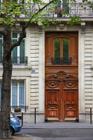 Paris, France - typical old apartment building. Street view.
