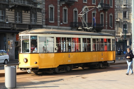 milano: MILAN - OCTOBER 6: Historic tram on October 6, 2010 in Milan. Milan is famous for using 200 historic Peter Witt streetcars in its transportation system carrying 1.7 million passengers daily (2007 data).