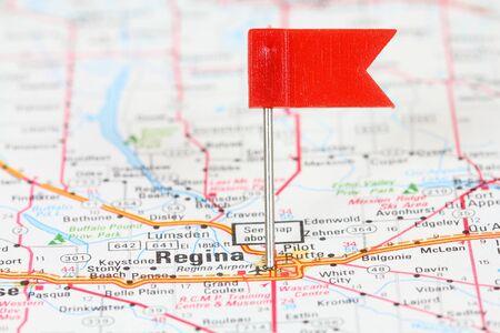 regina: Regina in Saskatchewan, Canada. Red flag pin on an old map showing travel destination. Stock Photo