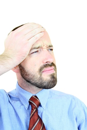 Migraine - businessman in pain. Young adult near his 30s - portrait isolated against white background. Short-haired male. Stock Photo - 12187830