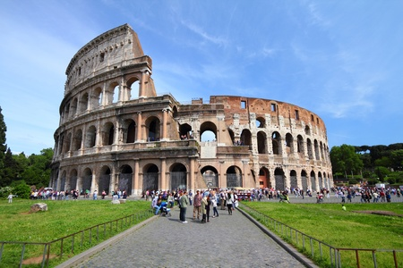 ROME - MAY 9: Tourists visit the Colosseum on May 9, 2010 in Rome, Italy. According to Euromonitors Destination Ranking, Rome is the 3rd most visited city in Europe (5.5m international tourist arrivals 2009) Editorial
