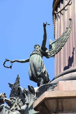 allegory: Barcelona monument - famous column of Christopher Columbus. Allegory of Freedom.
