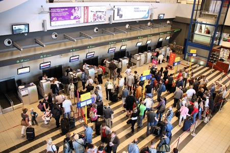 airport people: KATOWICE, POLAND - SEPTEMBER 1: Travelers wait for check-in on September 1, 2009 at Katowice Airport, Poland. With 2.366m passengers in 2010 it was the 3rd busiest airport in Poland.