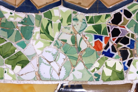 trencadi: BARCELONA, SPAIN - SEPTEMBER 13: Colorful mosaic in famous Parc Guell on September 13, 2009 in Barcelona, Spain. It is part of the UNESCO World Heritage Site Works of Gaudi, major Spanish landmark.