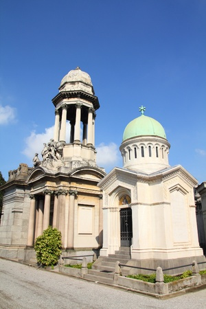monumental: Milan, Italy. Famous landmark - old graves at the Monumental Cemetery (Cimitero Monumentale). Religious art.